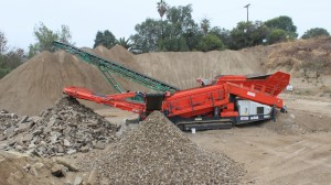 """Chandler's Sand & Gravel relies on a QE440 scalping screen from Sandvik to handle mixed loads such as concrete-asphalt. So far, Vice President Trevor Wood says the Sandvik unit is """"blowing through"""" the operation's material."""