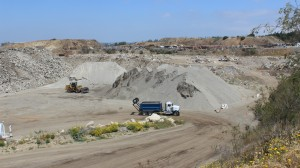 A look at some of the processed materials at Chandler's Sand & Gravel in Palos Verdes, Calif. A crushable concrete-asphalt pile is at the far left, while a Class 2 clean concrete base product is piled beyond the wheel loader. The third pile, at right, contains a Class 2 crushed miscellaneous base product.
