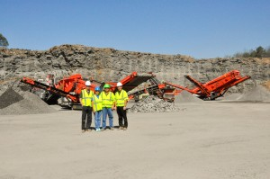 Hamilton Aggregates owners Genia and Edward Hamilton (center) pose with co-owners of their distributor, Crushing Tigers. Pat Doab (left) is managing director, and Brian Costello (right) is sales director.