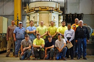 Mellott University's class of 2016, pictured with faculty and administrators in front of a crusher they assembled for their final exam. Photo courtesy of Mellott Co.